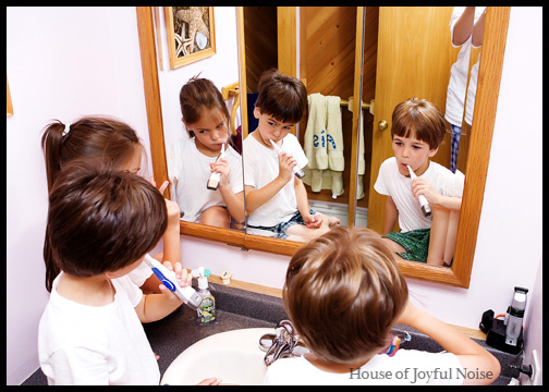 triplets-brushing-teeth