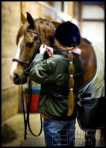 10_girl-unbuckling-horse-bridle