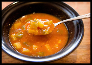 bowl of soup with spoonful