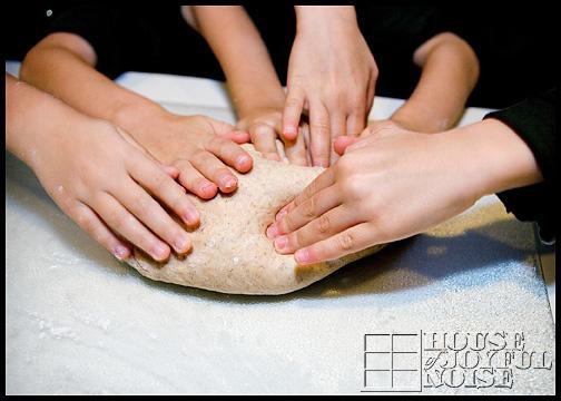 hands-kneading-dough