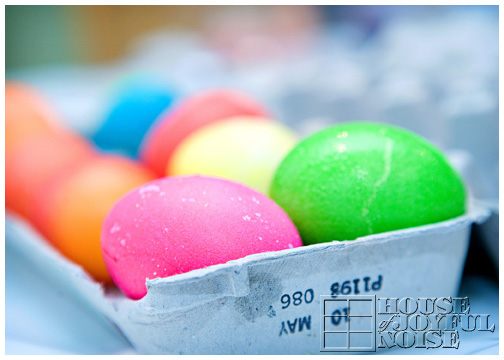 bright-colored-easter-eggs-in-carton