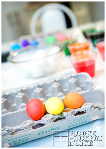 few-colored-easter-eggs-in-carton
