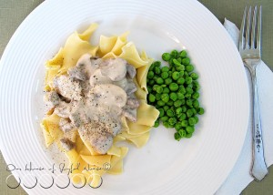 beef stroganoff over noodles with peas