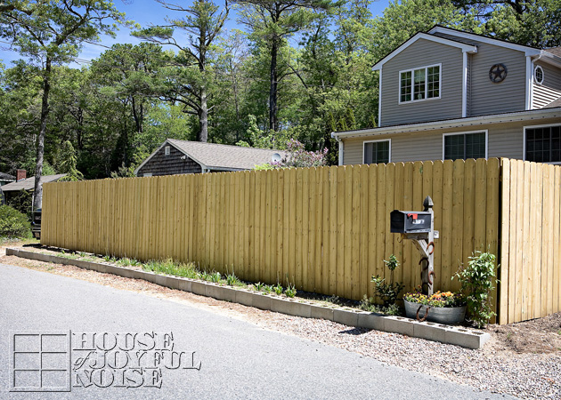 A Privacy Fence With An Eclectic Decorative Flair